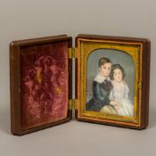A 19th century portrait miniature on ivory Depicting a young boy and girl inscribed Julian et