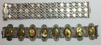 An unmarked white metal bracelet and an Eastern bracelet
