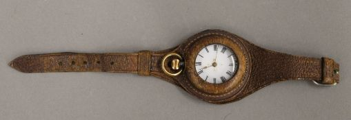A WWI officer's pocket watch converted to a wristwatch on leather strap