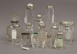 A collection of silver topped scent bottles