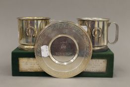 Two 800 silver horse racing trophy cups and a small silver trophy plate