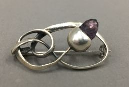 A sterling silver brooch