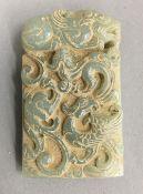 A carved jade rectangular pendant