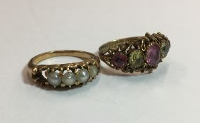 An unmarked gold pearl set ring and a stone set filigree ring (6.