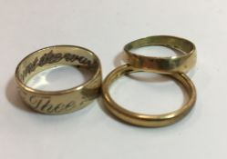 A 22 ct gold wedding band (3.5 grammes) and two 9 ct gold wedding bands (5.