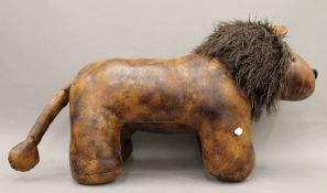 A leather footstool formed as a lion
