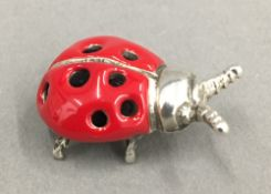 A silver ladybird form pin cushion