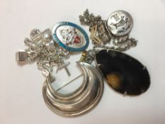 A quantity of assorted silver jewellery, enamel badges, etc.