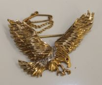 A 9 ct gold eagle form brooch set with diamonds and a ruby (5.