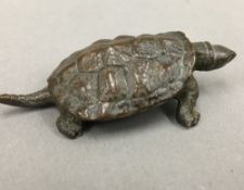 A small Japanese bronze model of a tortoise