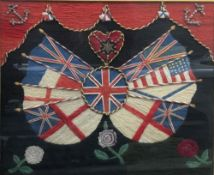 A sailors woolwork picture depicting various flags centred with the Union Flag beneath a heart,