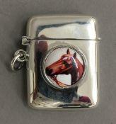 A silver vesta depicting a horse