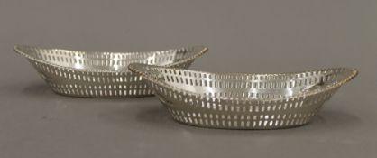 A pair of silver bon bon dishes (4.