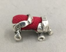 A silver pin cushion in the form of a roller skate
