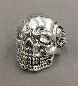 A skull form ring