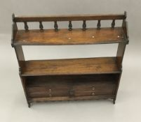 Two Victorian oak hanging shelves. 61.5 cm wide; 68 cm high; 17.