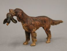 A cold painted bronze retriever with a duck