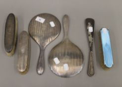 A quantity of silver dressing table items,