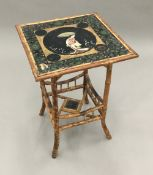 A Victorian bamboo table with chinoiserie lacquered top