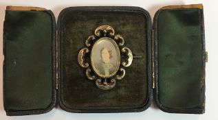 A Victorian yellow metal framed portrait miniature mourning brooch,