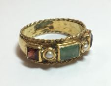 An unmarked high carat gold gem set ring (4.1 grammes total weight). Ring size R/S.