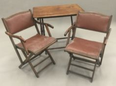 A pair of early 20th century folding chairs and a folding table