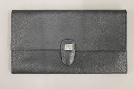 An unused leather passport, document and currency wallet,
