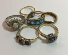 Three 9 ct gold dress rings, an unmarked ring and two other dress rings (12.