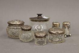 A quantity of various silver mounted jars, etc.