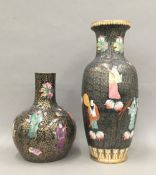 Two Chinese famille noir vases