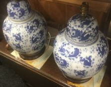 A pair of large Oriental blue and white table lamps
