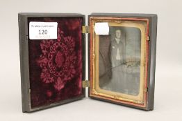 A coloured daguerreotype photograph in a pressed case