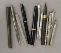A collection of pens and pencils