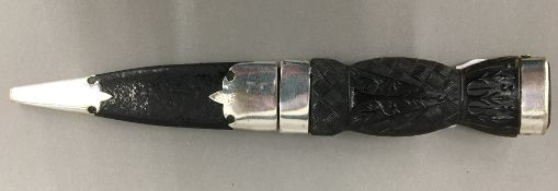 A Victorian Scottish skean dhu (sgian dubh) with pressed horn grip,