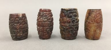 Four carved agate beads