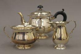 A three piece silver tea set (16.