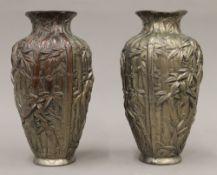 A pair of Japanese cast metal vases with bamboo decoration