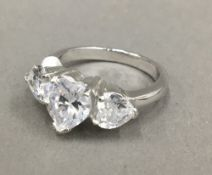 A silver cubic zirconia heart ring