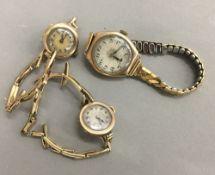 Three gold cased ladies wristwatches,