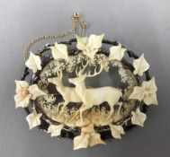 A 19th century Continental carved ivory brooch,
