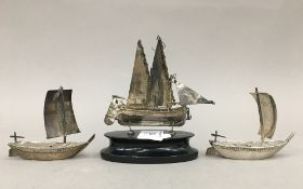 Three Chinese silver models of junks