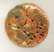 A Chinese carved agate roundel