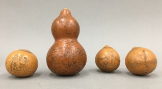 An antique Chinese double gourd profusely decorated with boys in various pursuits and three smaller