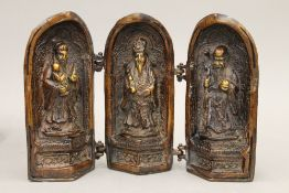 A Chinese bronze triptych shrine