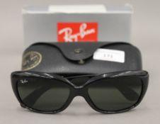 A boxed pair of Ray-Ban sunglasses