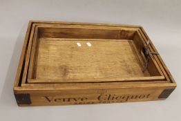A set of Moet Chandon wooden trays