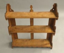 A set of Victorian elm hanging shelves. 63.5 cm wide; 68 cm high; 17.5 cm deep.