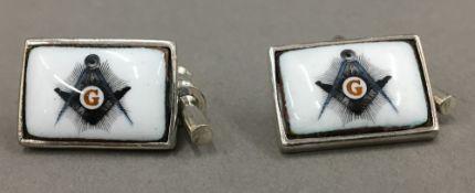A pair of silver Masonic cufflinks