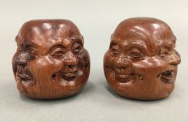 Two wooden four face Buddha heads