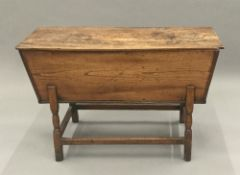 A 19th century elm dough bin